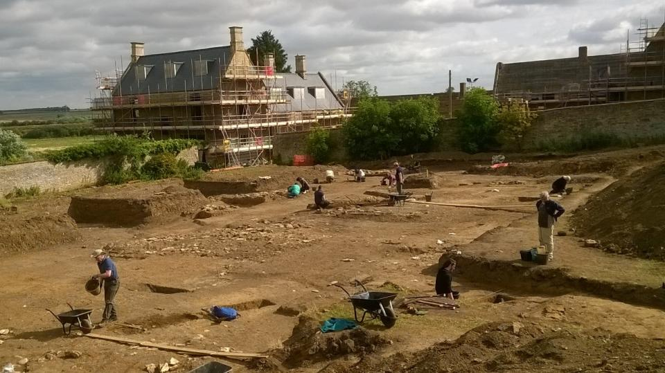 The excavations at Chester Farm in July 2017 with the farmhouse undergoing reconstruction in the background