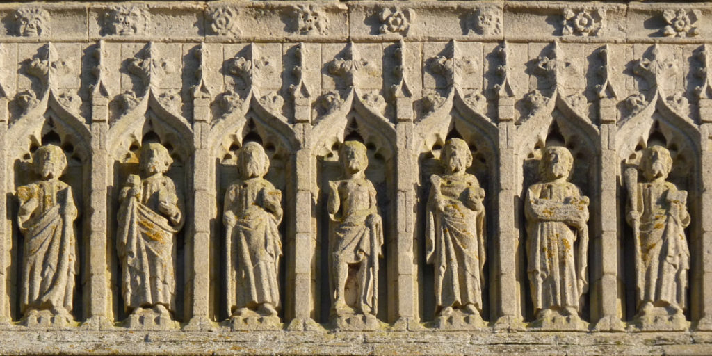 Stonework frieze of saints on the side of Thorney Abbey