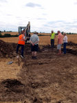 A discussion takes place as the excavted area grows