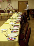 Table decorated with seasonal vegetation and set with cutlery,and side plates with Union Jack napkins
