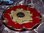 Marchpane, a dessert made from almonds in the shape of a Tudor rose, coloured red with a silvered centre and petal edges